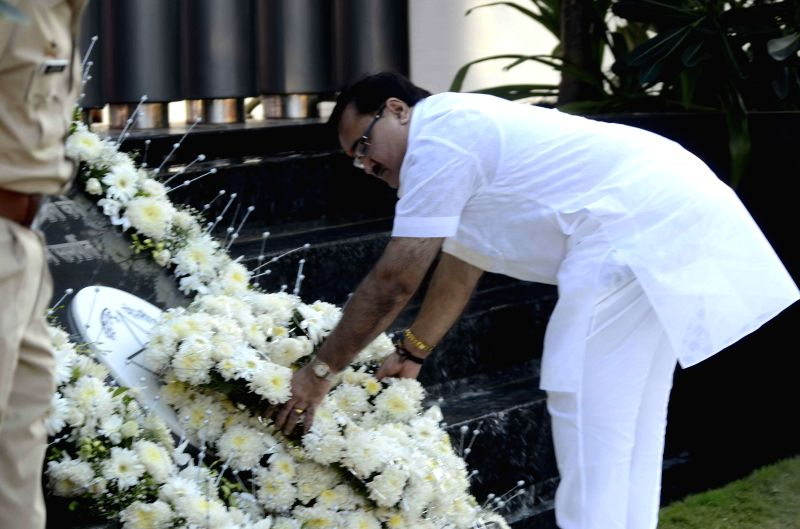Maharashtra Industry Minister Prakash Mehta pays homage to those killed in the 26/11 attacks during a programme at Police Gymkhana in Mumbai on Nov.26, 2014.Ten heavily armed Pakistani terrorists had