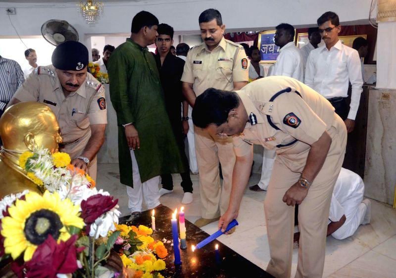 Maharashtra Joint Commissioner of Police (law & order) Dhananjay Kamalakar and Deputy Commissioner of Police Dhananjay Kulkarni pay tribute to Dr. BR Ambedkar on his birth anniversary at Chaitya . - Dhananjay Kulkarni