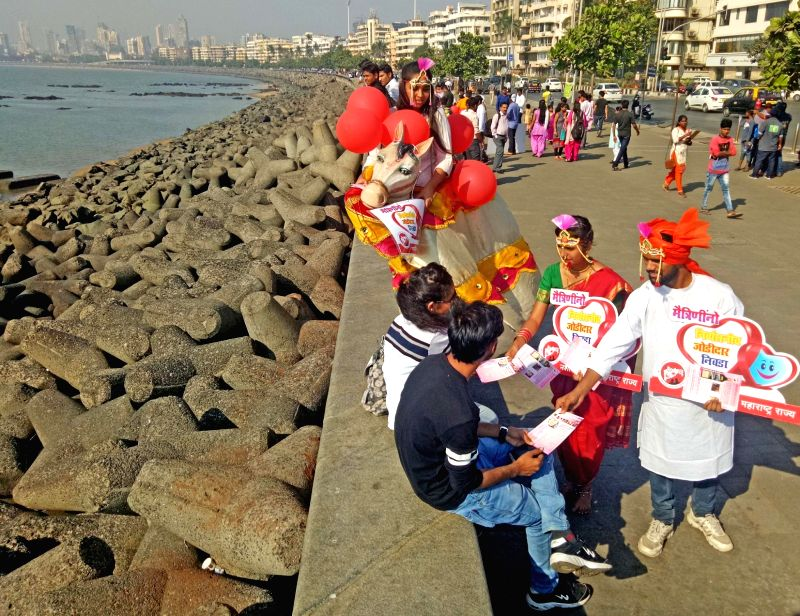 Maharashtra Nashabandi Mandal activists spread awareness against addictions ahead of Valentine's Day in Mumbai on Feb 13, 2018.