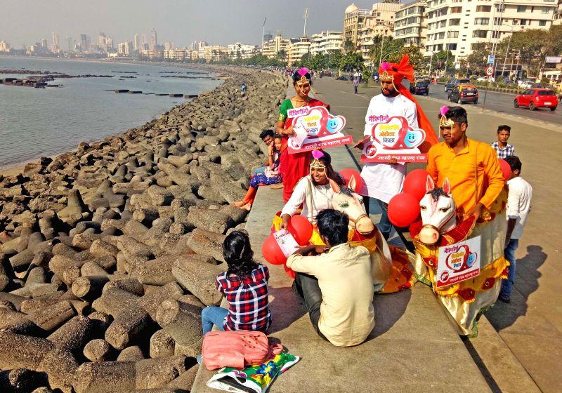 Maharashtra Nashabandi Mandal activists spread awareness against addictions ahead of Valentine's Day in Mumbai on Feb 13, 2018.