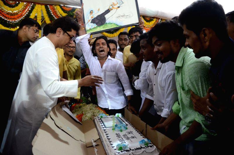 Maharashtra Navnirman Sena (MNS) President Raj Thackeray cuts a cake during his birthday celebrations at his residence in Dadar, Mumbai on June 14, 2018.