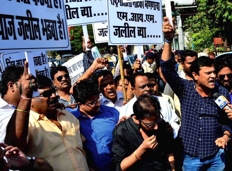 Maharashtra Navnirman Sena workers stage a demonstration against AIMIM MLA Imtiyaz Jalil's remarks on the national anthem in Mumbai, on Dec 1, 2015.