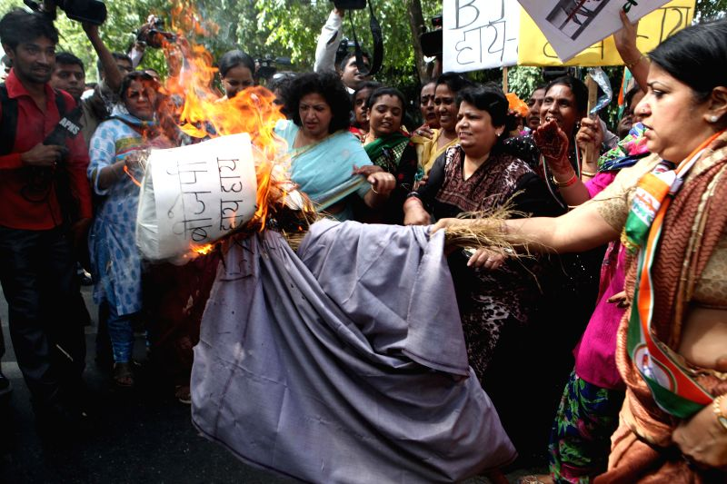 Mahila Congress workers demonstrate against Union Minister for Finance, Corporate Affairs and Defence Arun Jaitley for his recent remarks regarding Nirbhaya Rape Case in New Delhi on Aug 22, 2014.