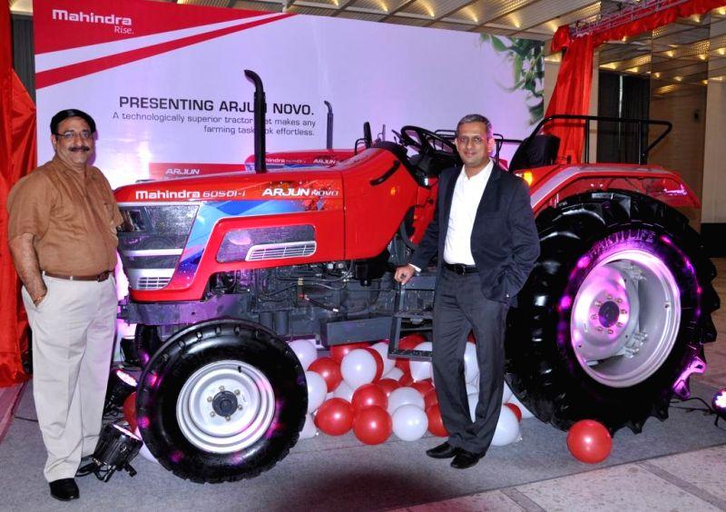 Mahindra and Mahindra officials Vijay Sharma and Ravindra Shahane launch Arjun NOVO tractors in Pune on Aug 22, 2014. - Vijay Sharma