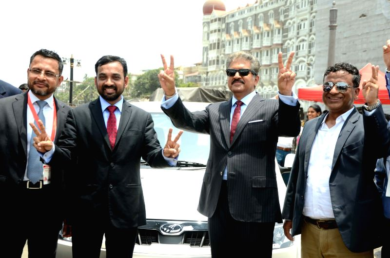 Mahindra Electric CEO Mahesh Babu and Mahindra Group Chairman Anand Mahindra at the flagging off ceremony of Electric Vehicles at the launch of a service where all-electric city car will be ...