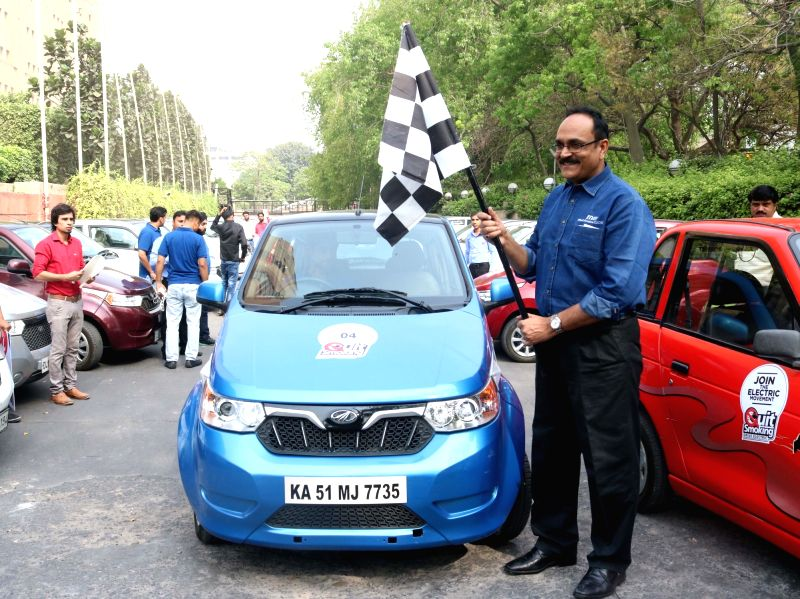 """Mahindra Electric Mobility vice president marketing Dharmendra Mishra flagged off a car rally to campaign for """"The Quite Smoking Drive of all Electric Vehicles"""" on """"World ... - Dharmendra Mishra"""