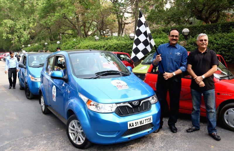 Mahindra Electric Mobility vice president marketing Dharmendra Mishra and Mahindra & Mahindra Ltd senior general manager Pawan Sachdeva flagged off a car rally to campaign for ... - Dharmendra Mishra