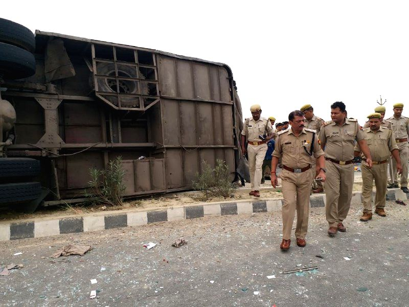 : Mainpuri: Police personnel at the site where a private double-decker bus overturned and hit the divider after its driver apparently dozed off, in Uttar Pradesh's Mainpuri district on June 13, ...