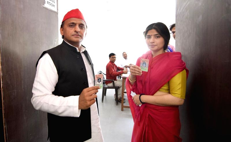 Mainpuri: Samajwadi Party (SP) President Akhilesh Yadav and his wife Dimple Yadav arrive to cast their votes at for the third phase of 2019 Lok Sabha elections, at a polling station in Uttar Pradesh's Mainpuri, on April 23, 2019. (Photo: IANS)