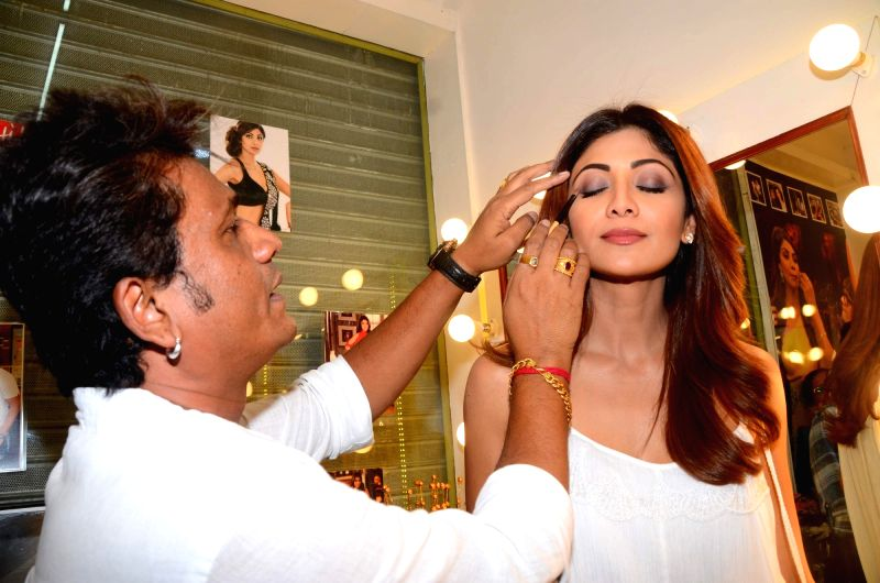 Makeup artist Ajay Shelar with actress Shilpa Shetty during the launch of his training academy in Mumbai on April 3, 2017. - Ajay Shelar and Shilpa Shetty