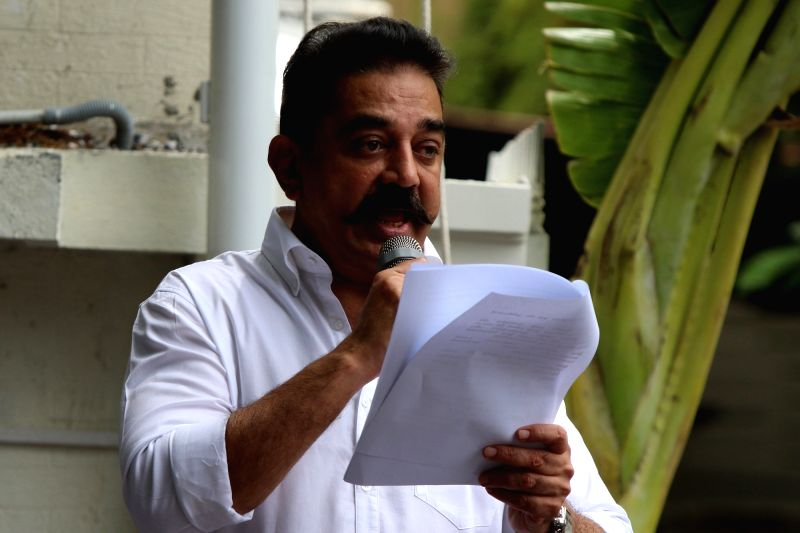 Makkal Needhi Maiam (MNM) chief Kamal Hassan addresses party workers after hoisting his party's flag and announcing the names of his party's office bearers at the party office at Alwarpet, ... - Kamal Hassan