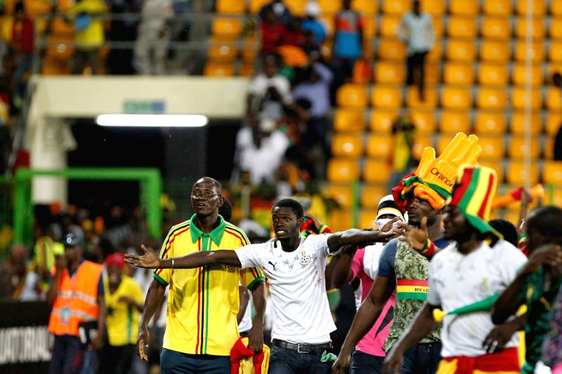 Supporters of Ghana enter the field during the semi-final match of Africa Cup of Nations between Ghana and Equatorial Guinea in Malabo, Equatorial Guinea, Feb. 5, ...