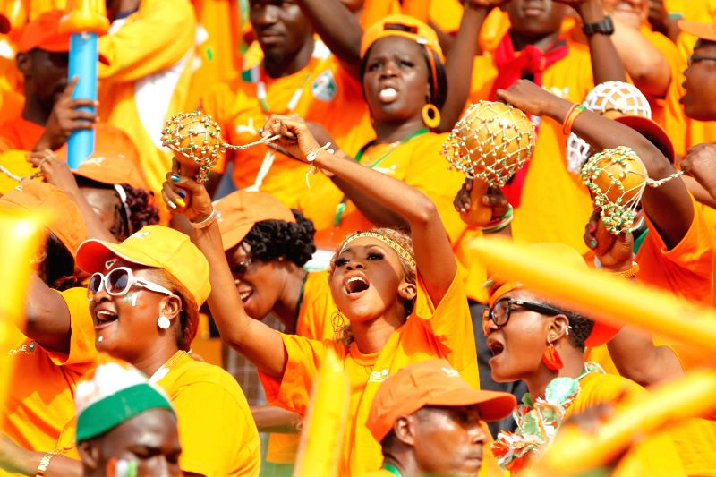Fans of Cote d'Ivoire cheer before the group match of Africa Cup of Nations between Cote d'Ivoire and Mali in Malabo, Equatorial Guinea, Jan. 24, 2015. The match ...