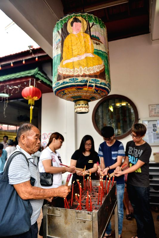 MALACCA, May 21, 2016 - Buddhists pay their homage to the Buddha during the Vesak in Malacca, Malaysia, May 21, 2016. Vesak, also known as the Buddha Day, is a holy day observed by Buddhists in many ...