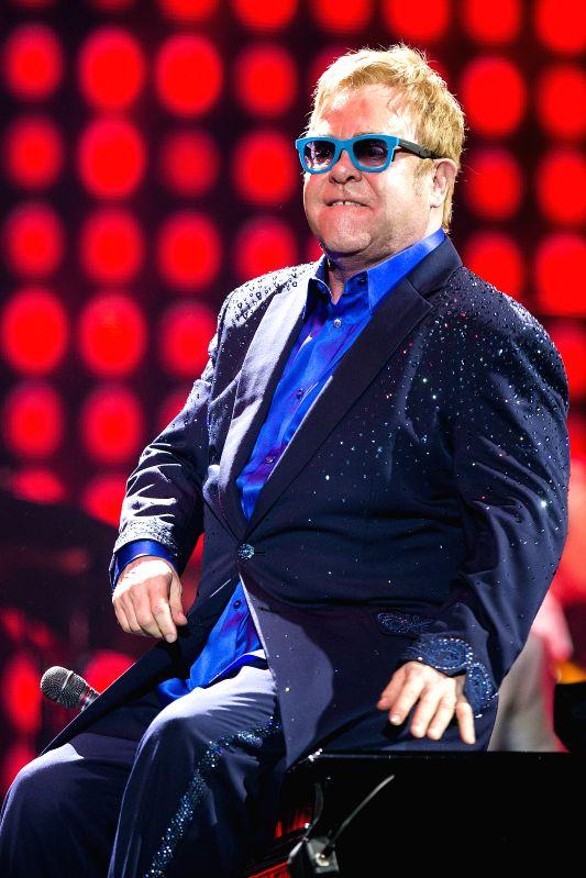 ":Malaga: British singer and songwriter Elton John performs during a concer at Palacio de Deportes José María Martín Carpena, upon his tour ""Elton John and his band"" in Malaga, Spain, on 15 July ..."