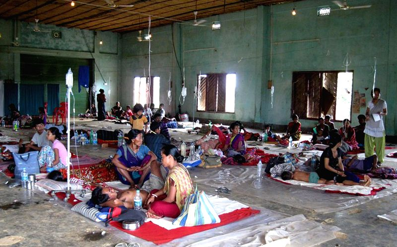 Malaria patients lie on the floor of a CRPF store room now being used as temporary health center in Mongiakami area in Khowai district of Tripura on July 5, 2014.