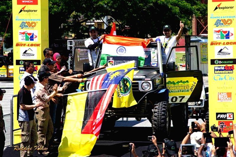 India's Kabir Waraich and Gurmeet Virdi during the flaging-off ceremony of the Rainforest Challenge 2014 in Malaysia on Dec 1, 2014.