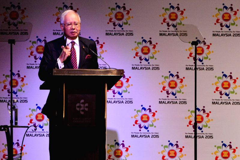 Malaysian Prime Minister Najib Razak addresses a signing ceremony of the Association of Southeast Asian Nations (ASEAN), in Kuala Lumpur, Malaysia, Nov. 22, ... - Najib Razak