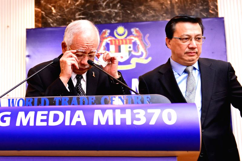 Malaysian Prime Minister Najib Razak (L) attends a press conference on the missing Malaysian Airlines flight MH370 in Kuala Lumpur, Malaysia, Aug. 6, 2015. ... - Najib Razak