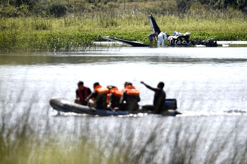 Uruguayan Navy Special Forces soldiers work at the place where the Beechcraft Kingair 90 plane crashed on Thursday, with nine Argentineans and one Portuguese on ...