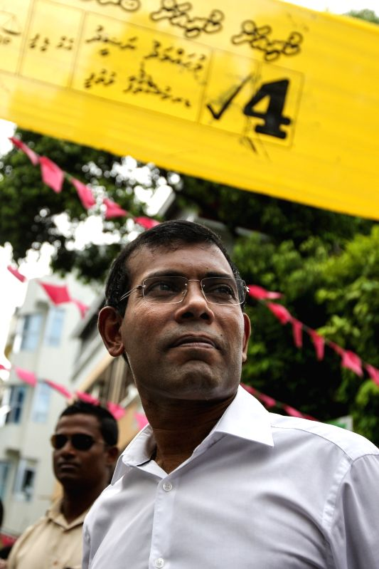 : MALE, Oct. 19, 2013 (Xinhua/IANS)Former Maldivian president and presidential candidate Mohamed Nasheed (C) of the Maldivian Democratic Party (MDP) attends a protest in Male, Maldives, Oct. 19, ...
