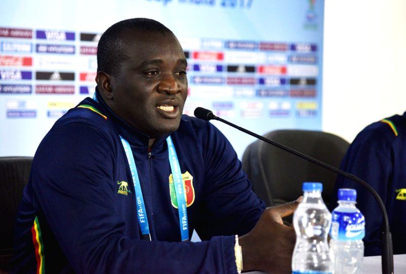 Mali U-17 head coach Jonas Komla addresses a press conference ahead of FIFA U-17 World Cup 2017 in Guwahati, on Oct 20, 2017.