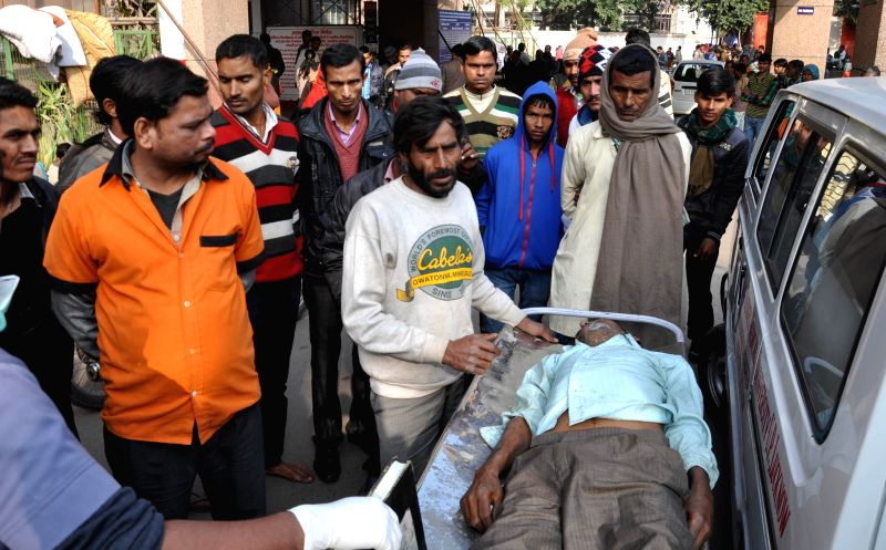 A person who was taken ill after consuming spurious liquor in Malihabad, being wheeled into a Lucknow hospital for treatment on Jan 12, 2015. Thirteen people including five from Malihabad .