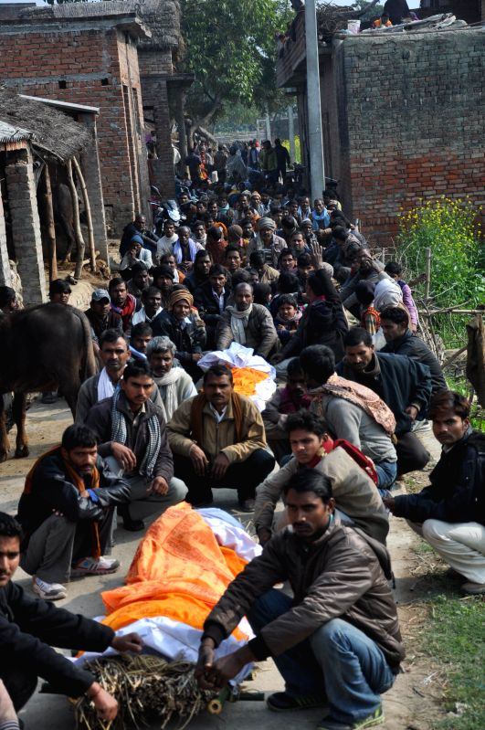 Villagers at the funeral of those who died Monday (12th Jan 2015) after consuming spurious liquor in Malihabad of Uttar Pradesh on Jan 13, 2015. Thirteen people died in Uttar Pradesh, ...