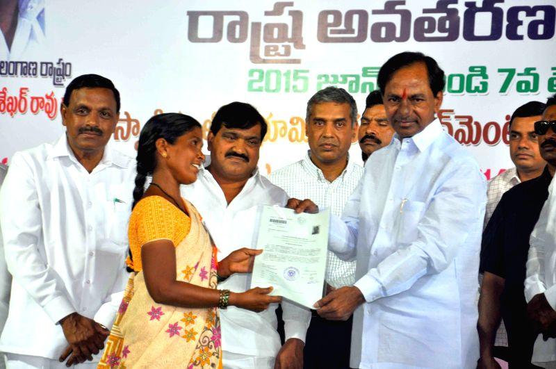 Telangana Chief Minister K Chandrasekhar Rao during a programme organised to distribute land documents to homeless in Malkajgiri on June 5, 2015. - K Chandrasekhar Rao