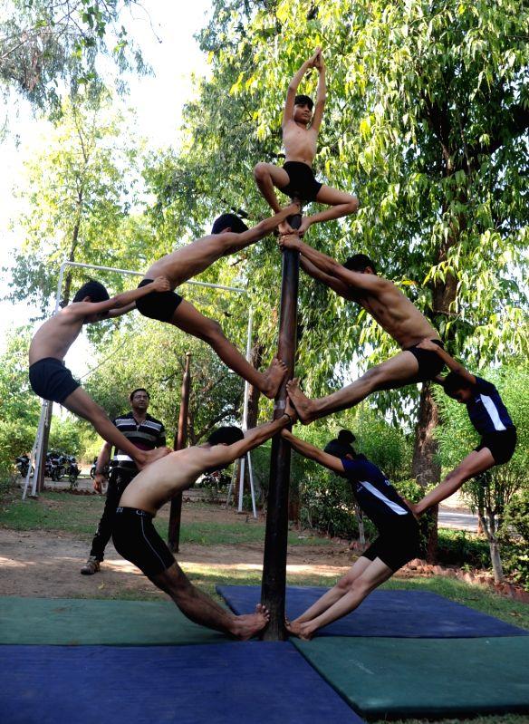 Mallakhamba preparations underway ahead of  Rath Yatra in Ahmedabad, on June 10, 2017.