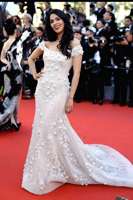 Mallika Sherawat looked ravishing in an embellished ivory trailed gown by Lebanese fashion designer Georges Hobeika at the opening night of the Cannes Film Festival.