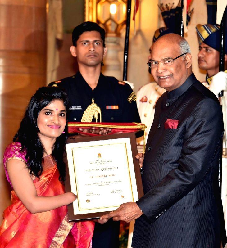 Malvika Iyer receiving Nari Shakti Puraskar 2017 from President Ram Nath Kovind. - Nath Kovind