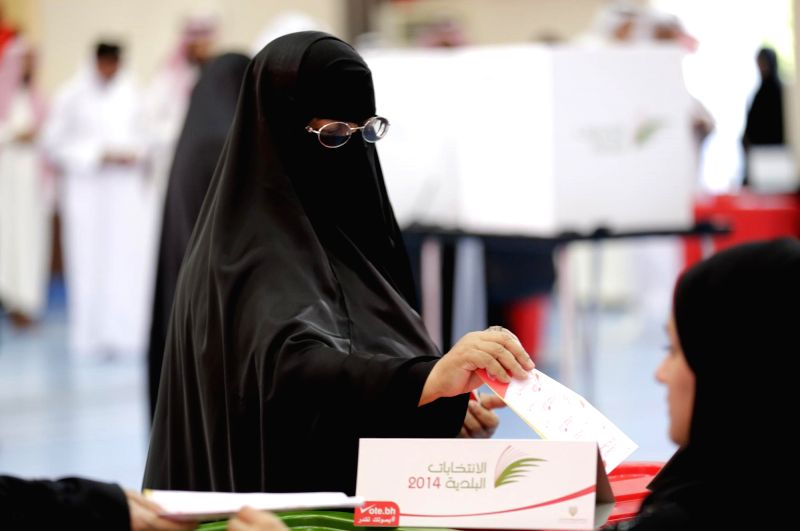 A woman casts her vote at a polling station in Riffa, Bahrain, on Nov. 22, 2014. Bahrain holds its first parliament election on Saturday since a failed protest in 2011 against the Sunni ...