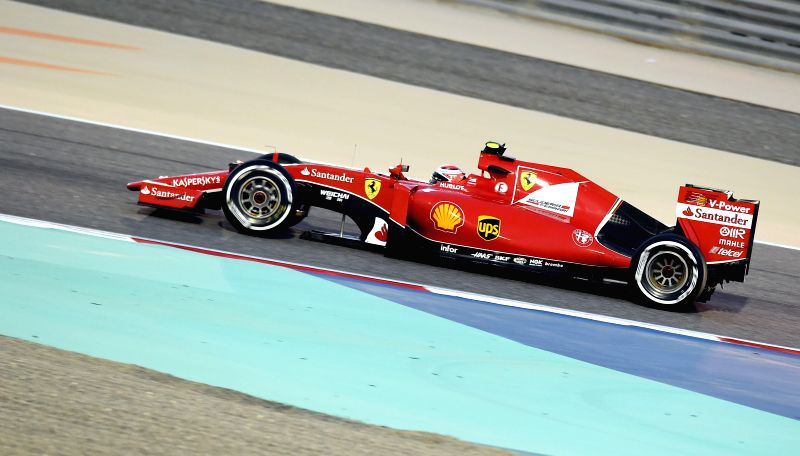 Ferrari Formula One Driver Raikkonen of Finland drives during the qualification session ahead of Bahrain's F1 Grand Prix at Bahrain International Circuit, south of ...
