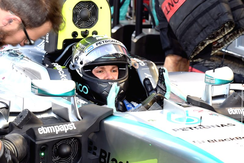 Third-place winner Mercedes Formula One driver Nico Rosberg of Germany prepares to take part in F1 Grand Prix at Bahrain International Circuit, south of Manama, ...