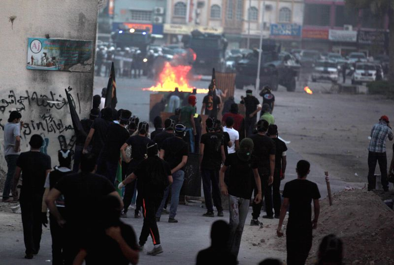 Bahraini protesters go to street and clash with riot police in Meqsha, west of Manama, Bahrain on April 22, 2014, after the funeral of Ahmed al-Mesgen, 16, and Ali .