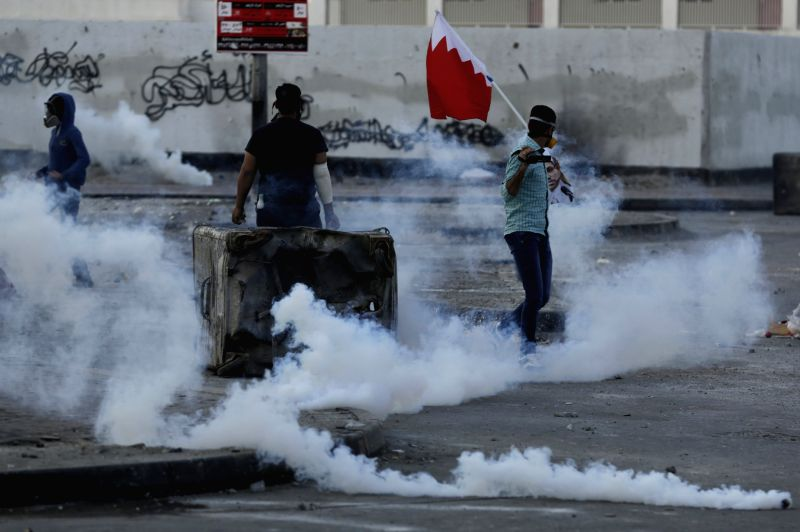 Bahraini anti-government protesters clash with riot police firing tear gas in Bilad Al Qadeem, Bahrain, on Jan. 2, 2015. Protests swept Friday many parts of Bahrain ..