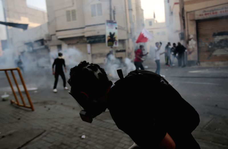 Bahraini anti-government protesters clash with policemen in Bilad Al Qadeem, a suburb of Manama, Bahrain, Jan. 5, 2015. Protesters demanded to free Jailed Bahraini ...