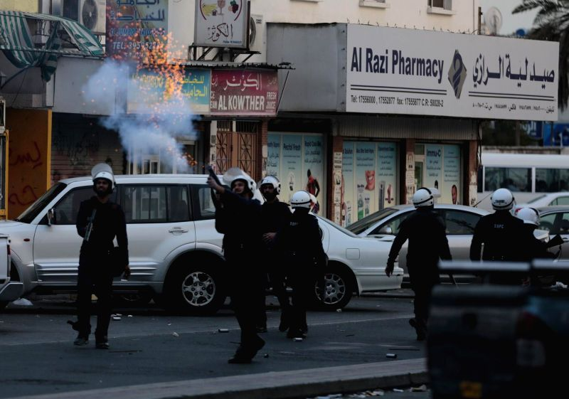 Bahraini riot police fire tear gas at Bahraini anti-government protesters during a clash in Daih, Bahrain, March 13, 2015. Baharaini shiite protesters held a ...