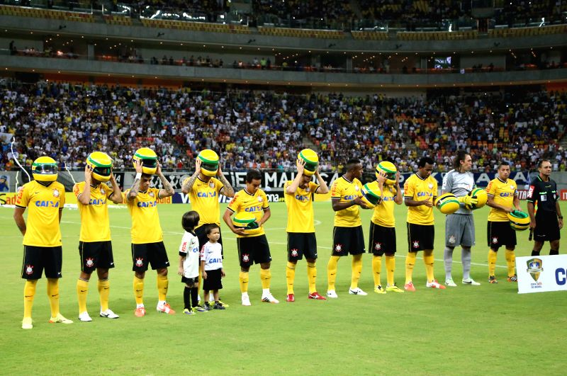 Players of Corinthians Sport Club wear helmets in hommage of the Brazilian driver, Ayrton Senna da Silva, during the 20th anniversary of his death, ahead of a match of