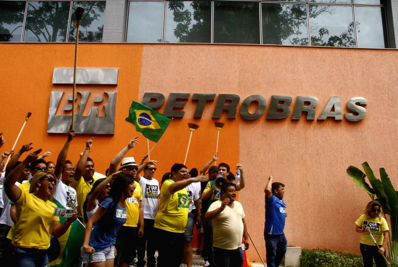 People take part in a protest against the corruption in the State's oil company Petrobras, in Manaus, Brazil, on Feb. 7, 2015. The Board of Directors of Petrobras ...