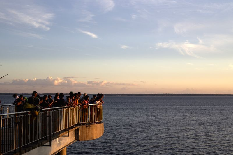 People watch the sunset in Ponta Negra in Manaus, Brazil, on June 15, 2014.