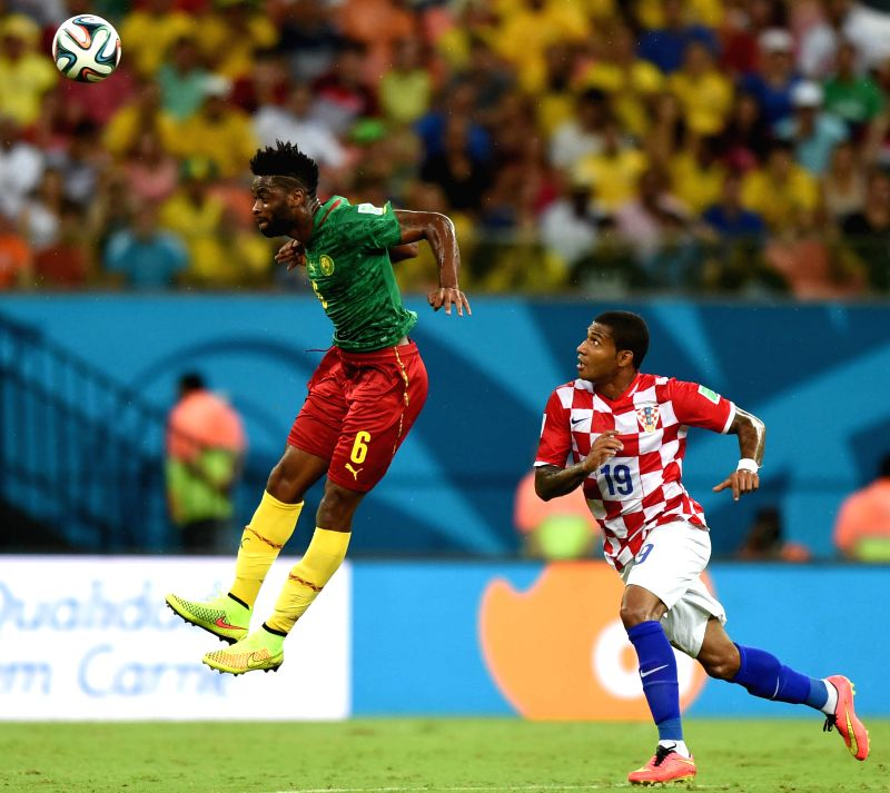 Cameroon's Alexandre Song competes a header with Croatia's Sammir Cruz Campos during a Group A match between Cameroon and Croatia of 2014 FIFA World Cup at the Arena