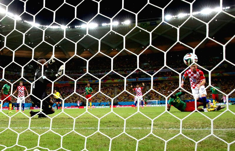 Croatia's Ivica Olic shoots a goal during a Group A match between Cameroon and Croatia of 2014 FIFA World Cup at the Arena Amazonia Stadium in Manaus, Brazil, June ..