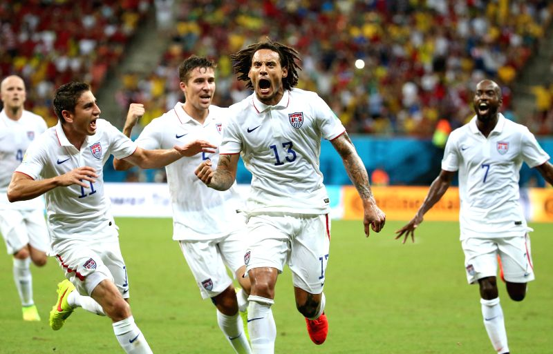 Jermaine Jones (2nd R) of the U.S. celebrates for scoring a goal during a Group G match between U.S. and Portugal of 2014 FIFA World Cup at the Arena Amazonia ...