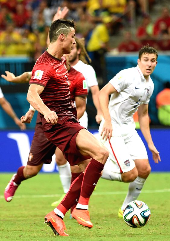 Portugal's Cristiano Ronaldo controls the ball during a Group G match between U.S. and Portugal of 2014 FIFA World Cup at the Arena Amazonia Stadium in Manaus, ...