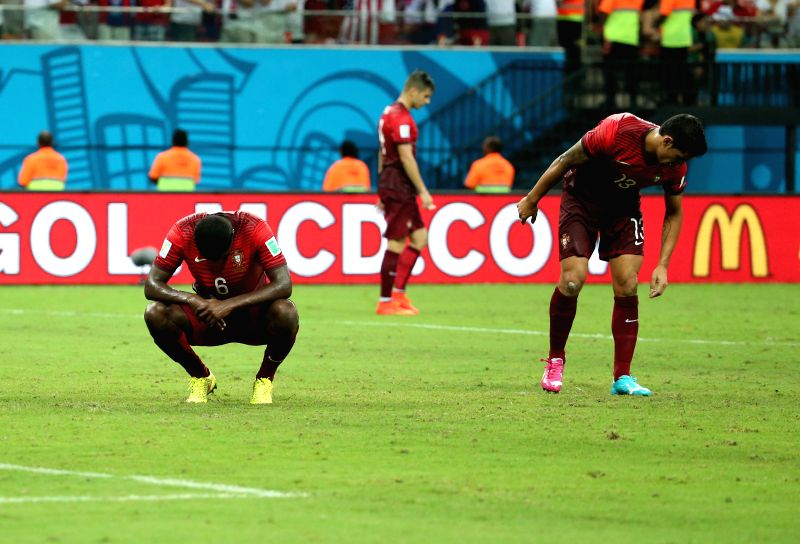 Portugal's William Carvalho (L) and Ricardo Costa react for the second goal of the U.S. during a Group G match between U.S. and Portugal of 2014 FIFA World Cup at ...
