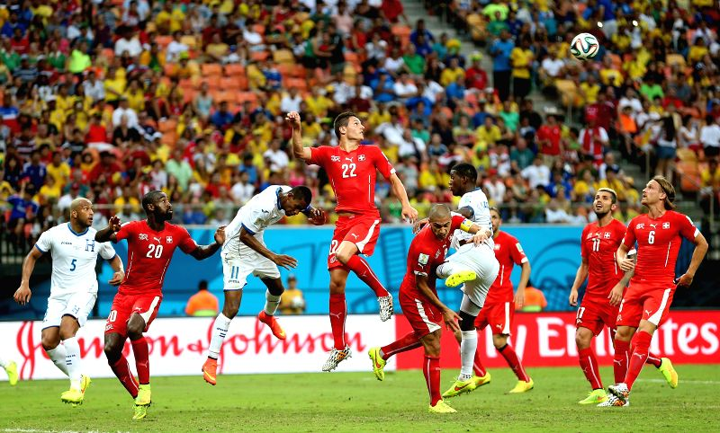 Switzerland's Fabian Schaer (4th L) heads the ball during a Group E match between Honduras and Switzerland of 2014 FIFA World Cup at the Arena Amazonia Stadium in ...