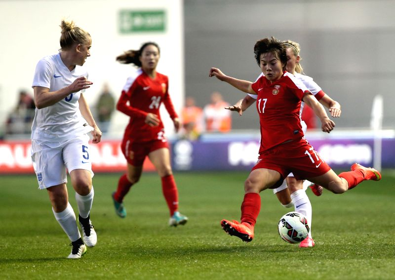 Wang Shuang (2nd R) of China competes during the women's international friendly match between England and China at the Academy Stadium of Manchester City FC in ...