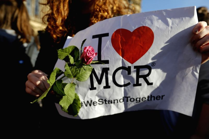 MANCHESTER (BRITAIN), May 23, 2017 People attend a candlelit vigil to mourn the victims of Manchester terror attack at Albert Square in Manchester, Britain on May 23, 2017. On Monday ...